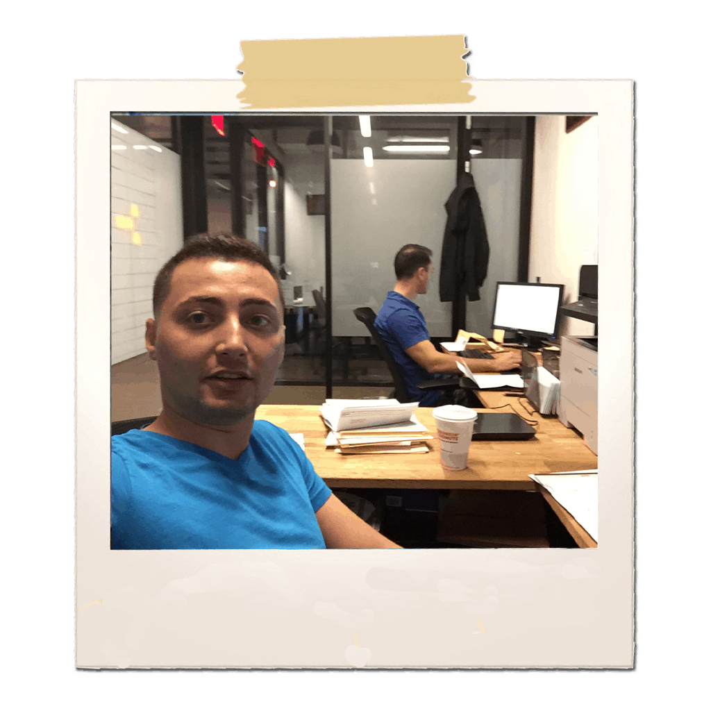 partners sitting in small office